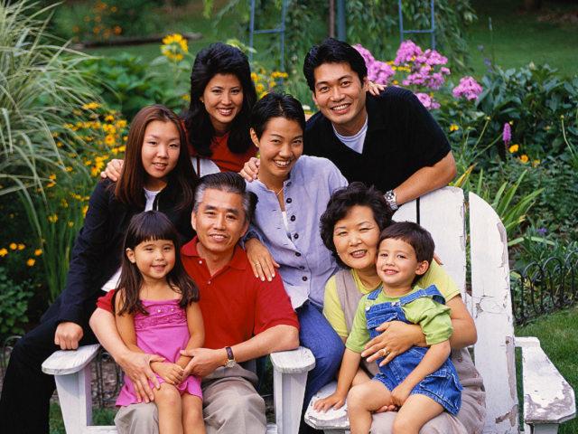 Photograph portrait of happy Asian family.